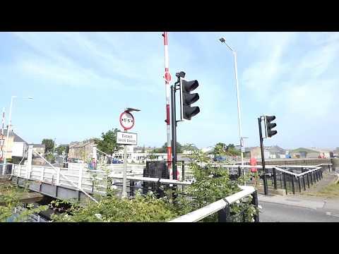 Road closed at Glasson Dock Lancaster UK swing bridge for boat passage through locks
