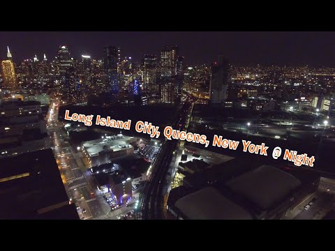Drone view of Long Island City at night 4k
