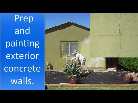 Painting exterior concrete walls of a house.