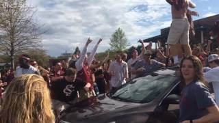 Students overtake car after South Carolina basketball advances to the final four