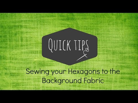 How to attach hexagons to the background fabric