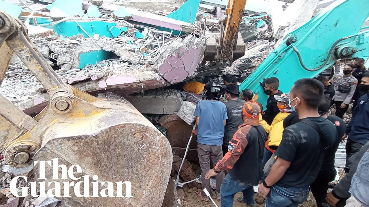 Indonesia earthquake: rescue workers search rubble with dozens reported dead