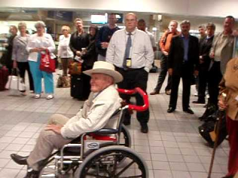 Medal of Honor John Finn boarding flight home