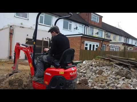 Using the 1 tonne kubota mini digger to back fill a trench