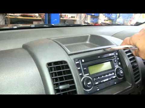 How to remove the  radio from a  Nissan Navara D40