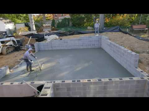 Timelapse of a concrete garage slab pour - 4K video
