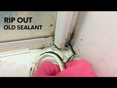 Ripping out old mouldy bathroom sealant
