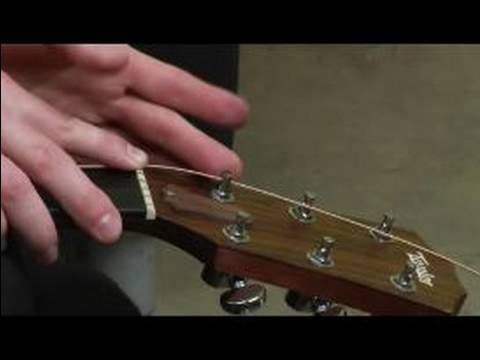 How to Change the Strings on an Acoustic Guitar : How to Lock the Guitar String into the Tuning Post