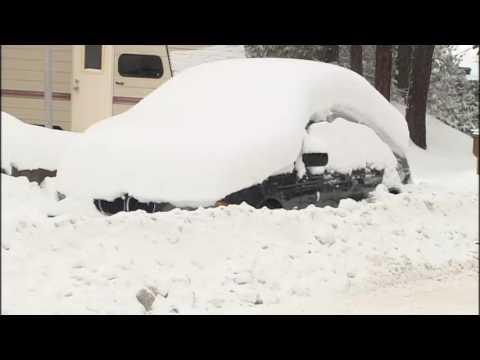 Snow shoveling Spokanites showing spirit