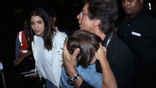 Shahrukh Khan shields sleepy Abram from media at the airport