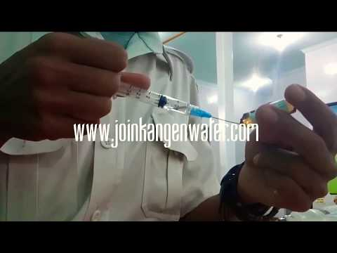 Nurse Working with Syringe Injection Free Slow Stock Footage - Japan KanGen Water Distributors