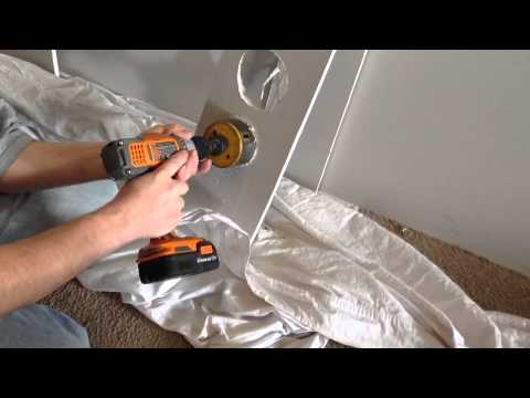 How to cut a round hole in drywall with a hole saw