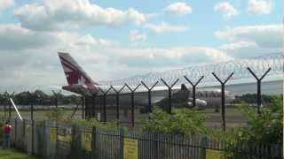 Pakistan International Airlines Landing Followed by a Qatar Airliner Taking off