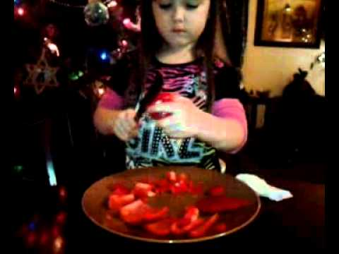 Lilia helping grandma cut up peppers for chili.