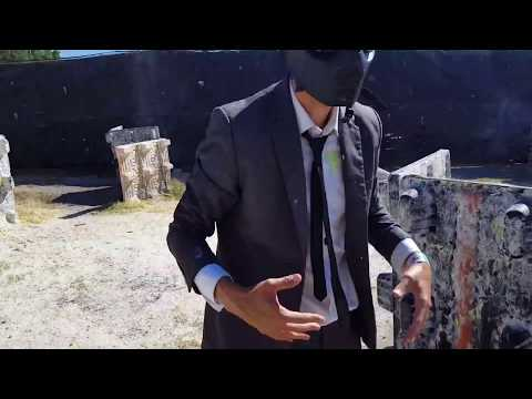 Getting shot with Paintballs in a Business Suit