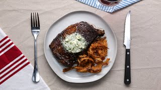 Rib Eye Steak With Blue Cheese Compound Butter And Crispy Onion Strings •Tasty