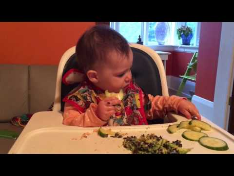 One year old eats cucumbers
