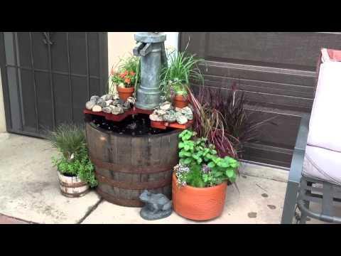 Whiskey barrel water-pump fountain