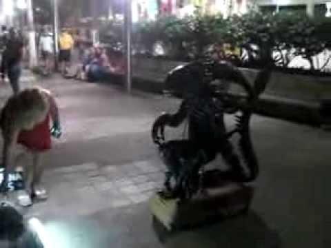Alien costume on the Malacon in Mexico