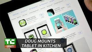 Doug mounts a tablet to the kitchen wall