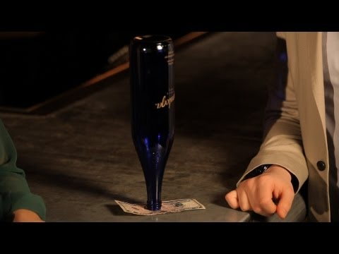 Pulling a Dollar from under Beer Bottle | Table Magic Tricks