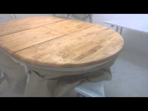 Spraying lacquer to a dining table