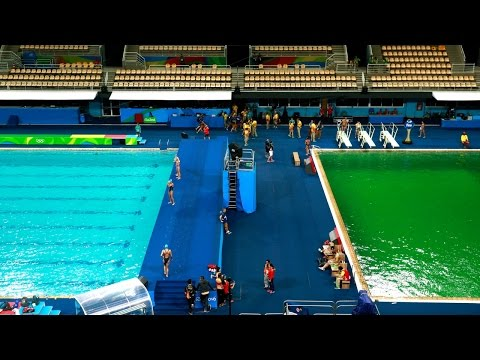 Olympic divers wonder why their pool is green