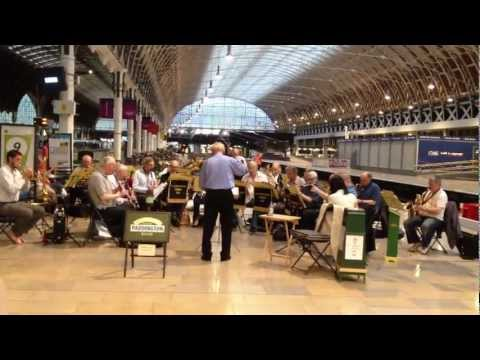 Orchestra playing in Paddington Train Station in London England
