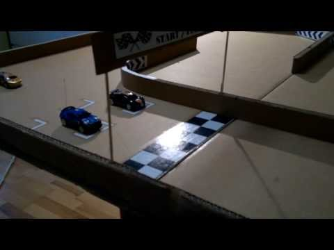 micro coke can car RC racing home made track from corrogated cardboard, can car