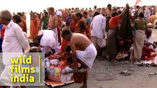 Dressing up after the holy bath: Gangasagar mela