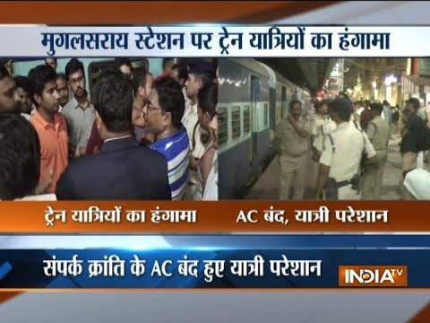 Passengers of Sampark Kranti Express protest at Mughalsarai station after AC system of train fails