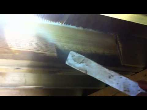Dry ice blasting smoke and soot off of a wooden floor joist