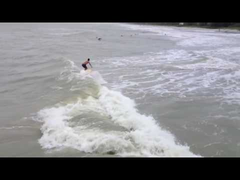 Surfing the Naples Pier   During Tropical Storm Debby