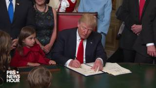Trump signs first official documents as U.S. president