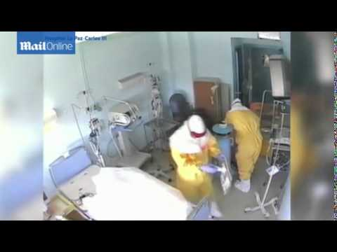 Hospital workers clean the room of Ebola...