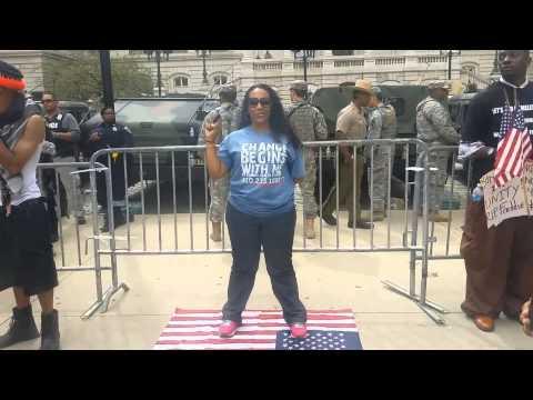 Erica Walker Steps on flag infront of Soldiers #ericsheppardchallenge