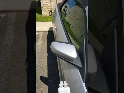 Reattaching side view mirror