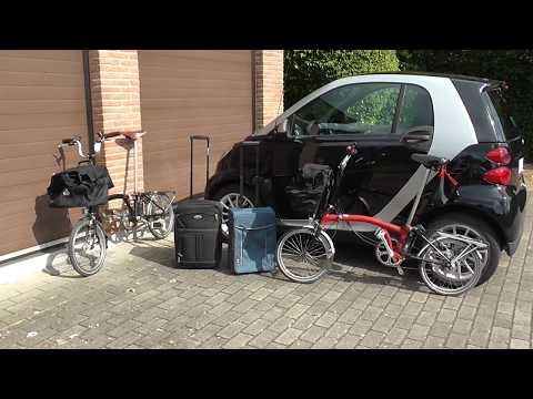 smart car trunk boot cargo size - will it fit 2 bicycles, 2 trolleys and 2 touring bags ?