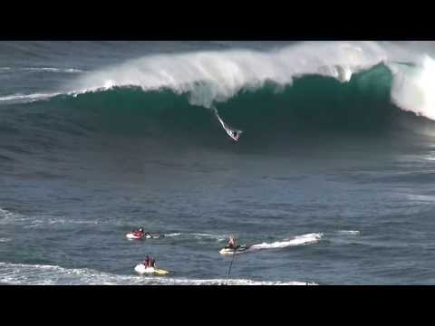 Surfer drawn in by tsunami waves at Jaws Maui Hawaii....testing drones techno.. stay tune up