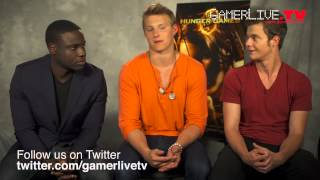 The Hunger Games Actors Dayo Okeniyi, Alexander Ludwig, and Jack Quaid Talk Blu-ray and Games