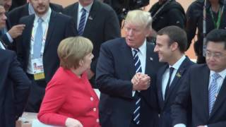 "Trump uses ""bro clasp"" to win handshake rematch with Macron"