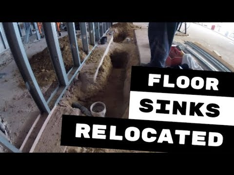 COMMERCIAL FLOOR SINKS RELOCATED FOR ICE MAKER DRAINS