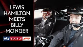 Lewis Hamilton gets behind the wheel with Billy Monger