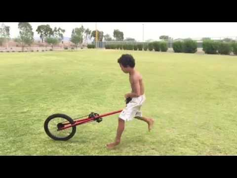 Kid Doing A Running Mount Into A BackflipCombo Off His Giraffe Unicycle