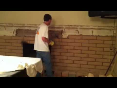 John's taking down our brick wall/fireplace