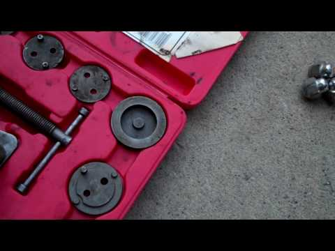 How to compress a rear brake caliper with a spiral piston