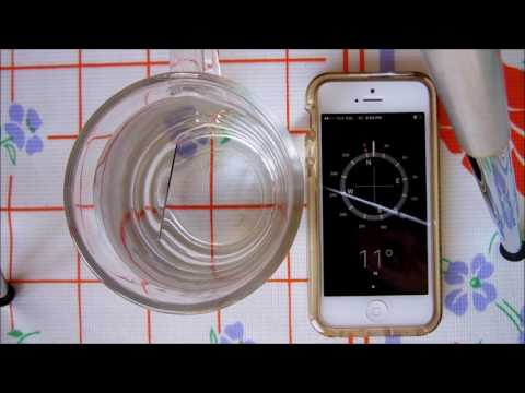 making a compass with sewing needle and water by using a magnet