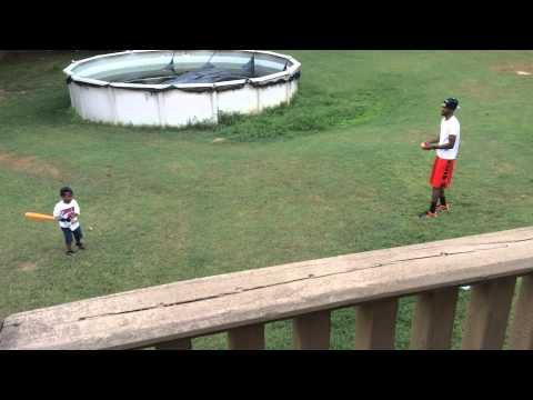 4year old playing baseball with his dad is determine to hit harder