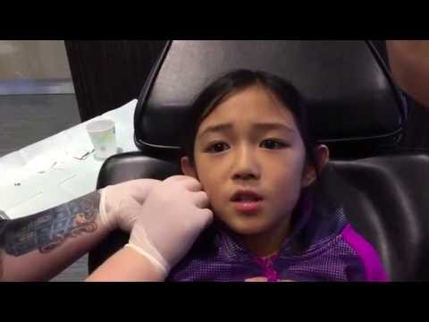 Painless ear piercing by needle