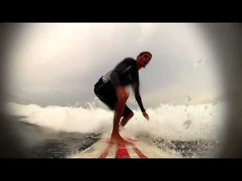 Learning how to surfing at Nusa Dua, Bali.